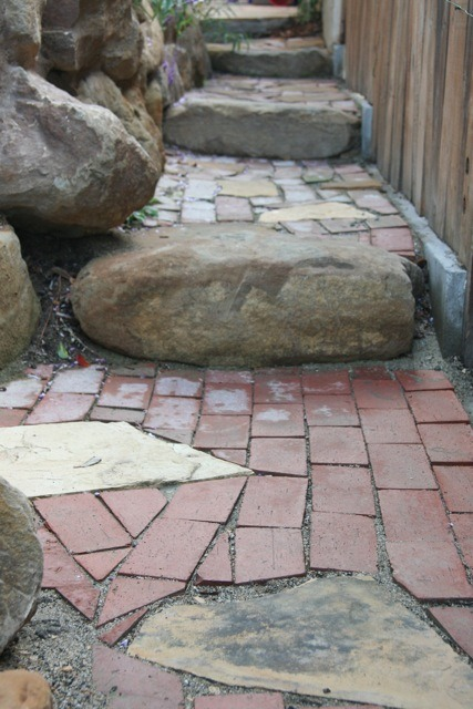 Topanga Canyon stone was used as stairs instead of railroad ties. The stone blends in very well with the Golden Buckskin and Moonlight flagstone in the path.