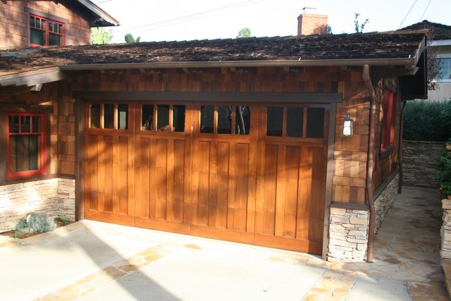 The garage door was made in four panels to facilitate roll-up. The theme of three can be seen in the door and windows.