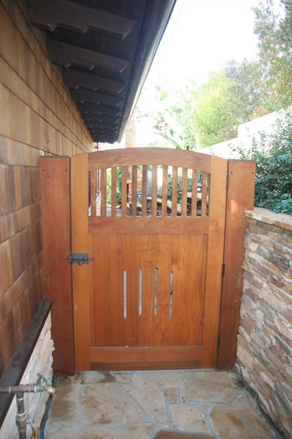 This cedar gate was made by Charles Prowell of <a href='http://www.prowellwoodworks.com' target='blank'>Prowell Woodworks</a>. It ties in nicely with the cedar shingles on the house.