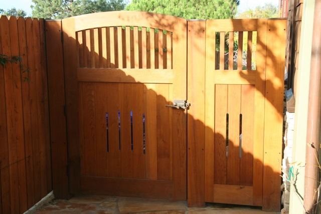 This cedar gate ties in nicely with the rest of the house. It was made by <a href='http://www.prowellwoodworks.com' target='blank'>Charles Prowell Woodworks</a>. There are ebony accents and copper caps for extra detail. The hardware is a Euro latch with a working handle on both sides.