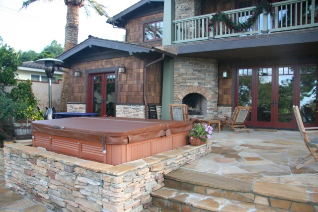 We make a lot of S'mores in the outdoor fireplace. Noticed the lower stone wall enclosing the hot tub? I actually had two doors made on steel frames and put on hinges. Nobody ever notices the doors and can't figure out how the hot tub got in there. :)