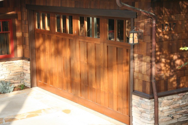 This roll-up garage door is made of mahogany and weighs in at 400 pounds.