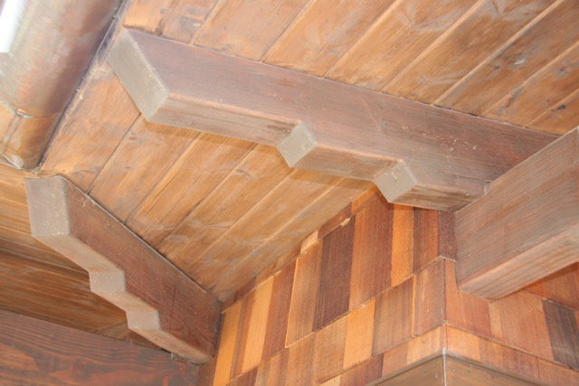 These rafter tails were all custom-made on site out of redwood. They were all stained by brush to give the look you see.