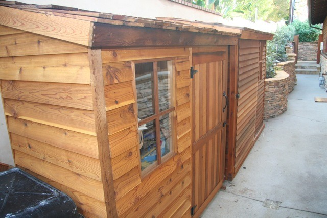 Another view of the cedar sheds. The close one is 6x3 with a swinging door while the far one is 8x3 with a sliding door.