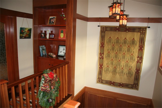 You can see the built-in American cherry bookcase and how the staircase, wainscoting, and picture rail had to be integrated together.