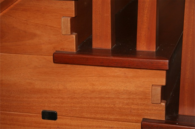 Another fine example of Dave Barlow's skills. Here you can see an ebony plug integrated into the mahogany siding.