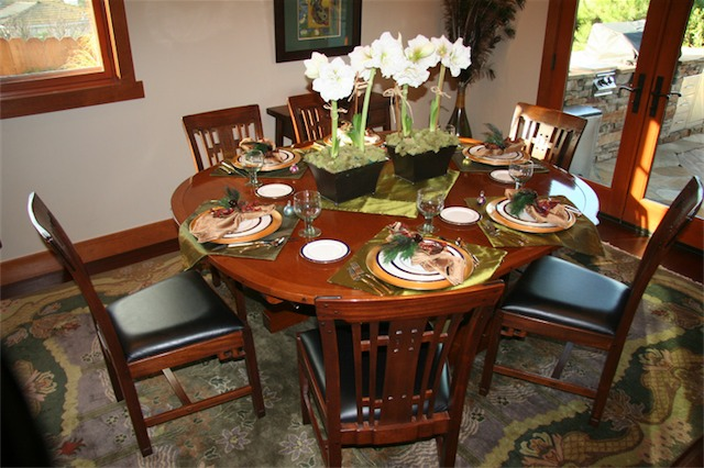The dining room table was built by Dave Barlow. It was inspired by the Robinson House table. The chairs are Blacker House dining chair replicas made by Stickley.
