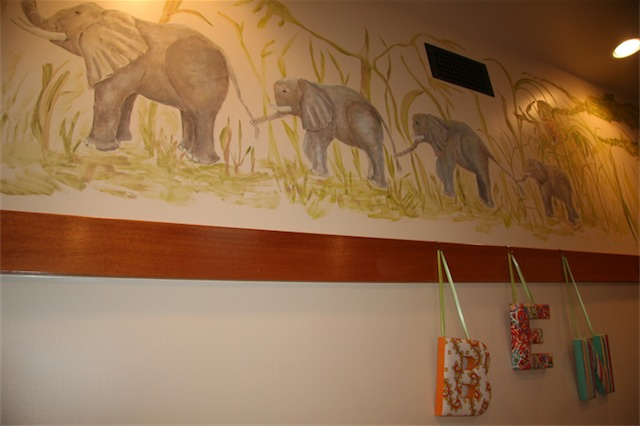 A cheetah is peering through the grass above the last baby elephant. What is amazing to me is that Margit Wypyszyk is not a professional painter. I believe this was her third mural. Her second mural is in my daughter's room.