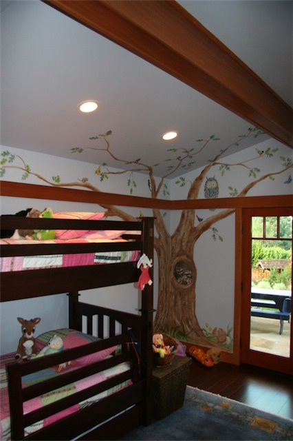 Amy had this idea for a mural with little animals and such. Notice how the tree wraps around the walls and onto the ceiling.