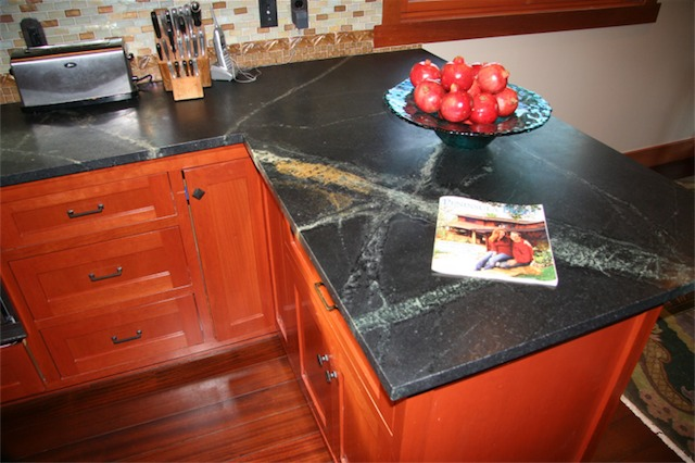 The mineral oil brings out the caramel and emerald color of the soapstone. On the counter is the December 2007 issue of Peninsula People showing my wife, Amy, and I in front of the house. This was good publicity for the Yule Parlor Parade Homes Tour.