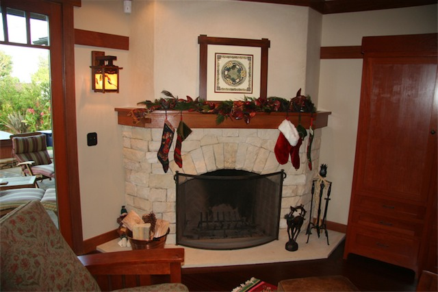 The fireplace is hand cut Moonlight flagstone with a limestone hearth. The mahogany mantel, like the staircase, has interlocking pieces at the joints. The mahogany and ebony lantern is a Greene and Greene reproduction from the Gamble House with my own stained glass panels.