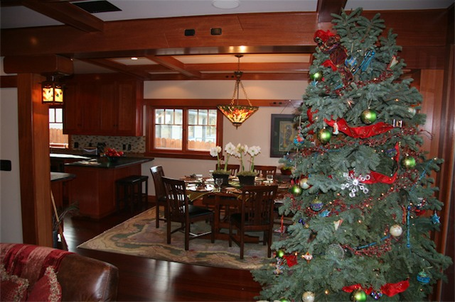 The living and dining rooms create one large space but feel like separate rooms due to the mahogany beam.