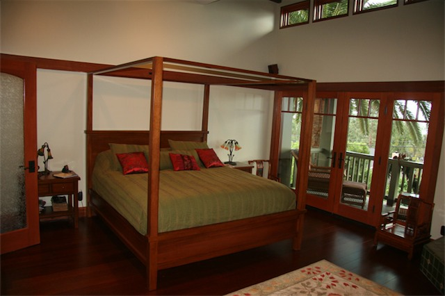 The mahogany canopy bed fills the space well being that the ceiling is vaulted.