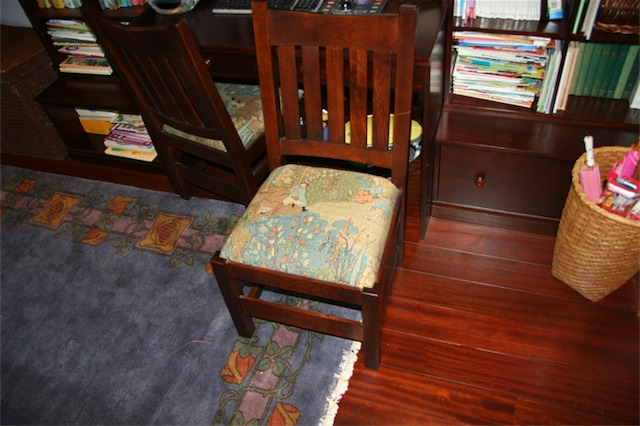 This small, oak chair is one of only six. When we were looking for our Stickley furniture, Amy and I went in to a clearance room. Two of these short chairs were sitting there so we bought them. The story is that a short lady ordered a custom set for her dining room table but when she came to pick them up she said that only midgets could use these. She wasn't thinking outside the box as these are perfect for kids.