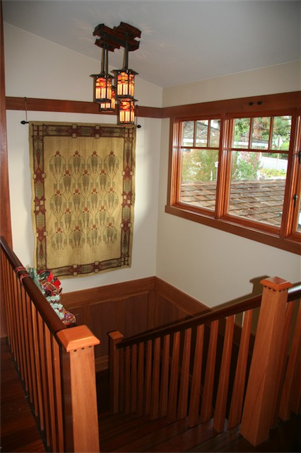 I am standing outside the office looking at the Honduran mahogany staircase. The handrail is made of Brazilian cherry just like the floor. If you look closely, ebony accents (teeth) can be seen just below the cap on the newel posts.<br />The tapestry is a Mackintosh design and fills the wall space nicely.<br />The chandelier was designed by Su Bacon and built by New York artist, Karl Berry. The Mahogany canopy that it hangs from was built by master woodworker Sam Mossaedi.
