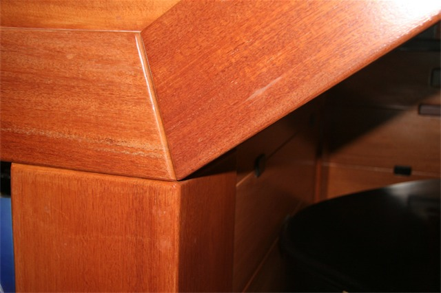 The wood edges are always rounded where two pieces meet. The larger the piece the larger the radius placed on the edge.