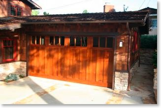 The stained mahogany Craftsman garage door