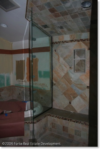 Master bathroom is tiled in glass, slate, and seagrass limestone.
