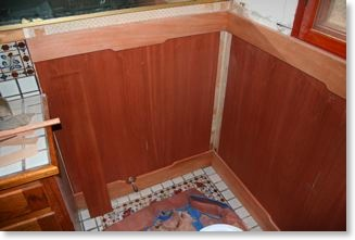 Mahogany, bathroom wainscot being installed