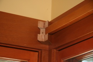 Corner curtain rod bracket installation