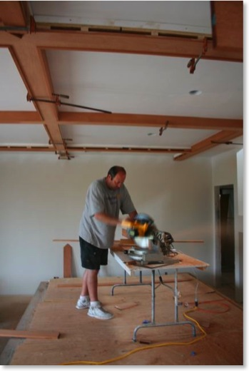 Dave Barlow installs the living room beams