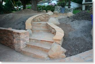 Craftsman walkway in front yard made of stone.