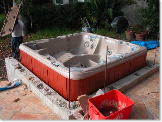 The hot tub has been slid into place