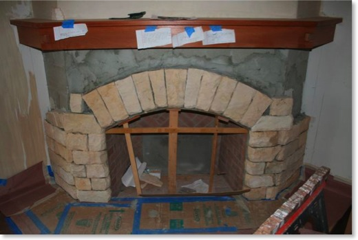 The Moonlight flagstone is being installed on the living room fireplace.