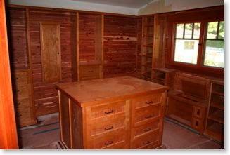 Master closet lined in cedar with cherry cabinets