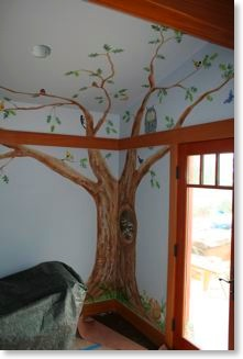 Mural of an oak tree with animals in the girls' bedroom.