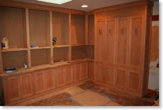 Unfinished library cabinets with built-in Murphy bed.